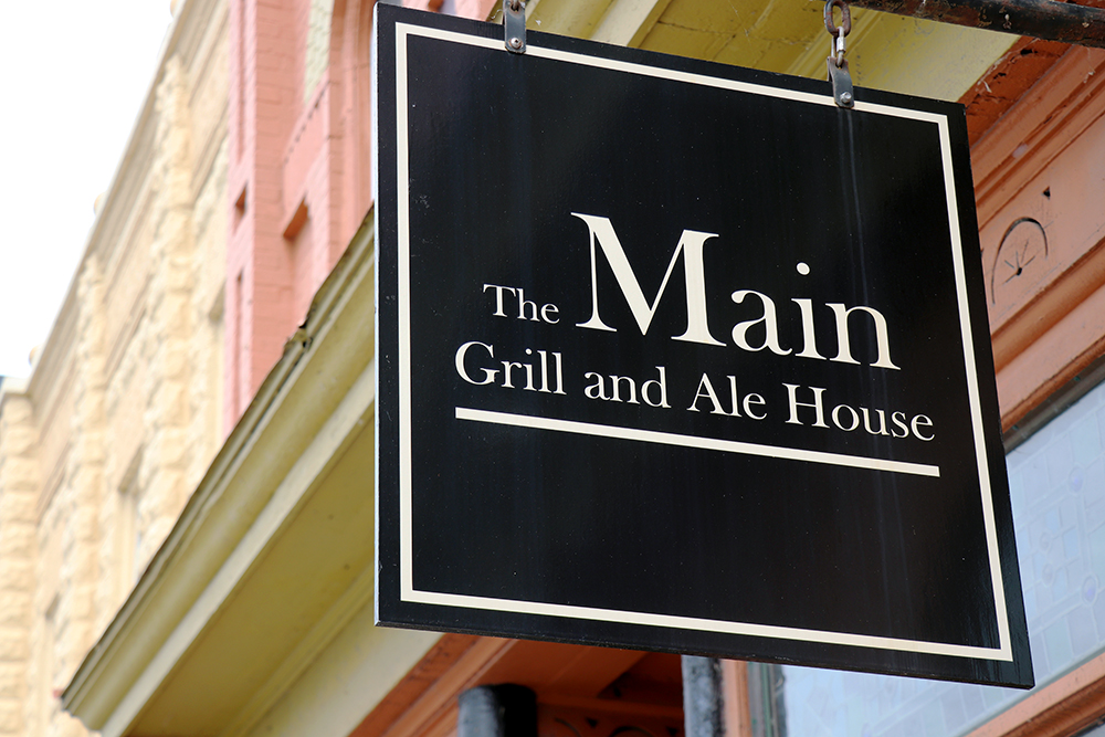The Main Grill and Ale House logo